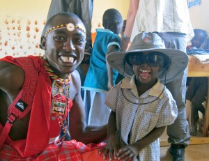 Raines in March wearing my hat and sunglasses (that's Solomon our Masai guide)