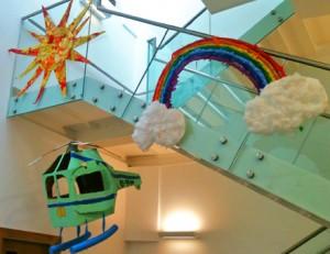 Sun and rainbow overhead Trinity's helicopter