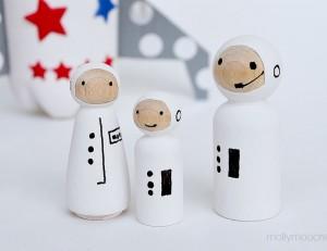 plastic bottle rocket ship with peg doll astronauts