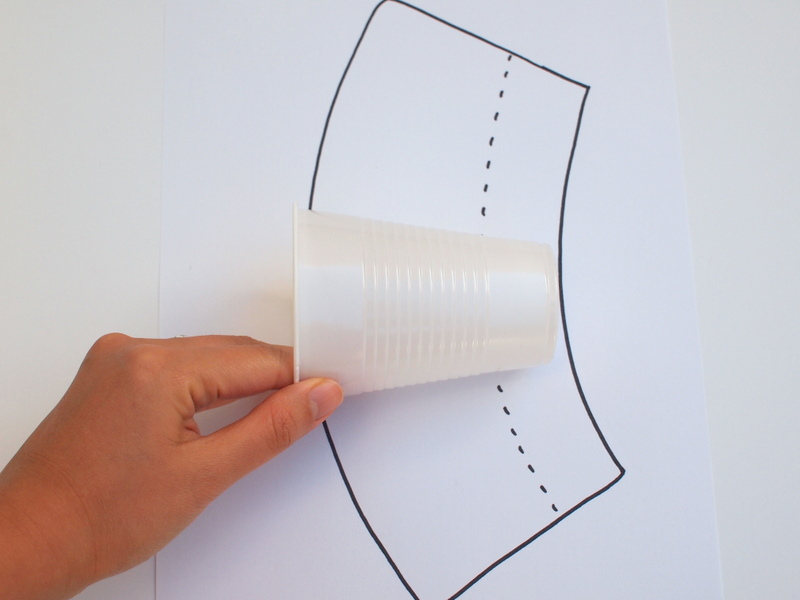 roll the cup to make paper cup angel luminaries